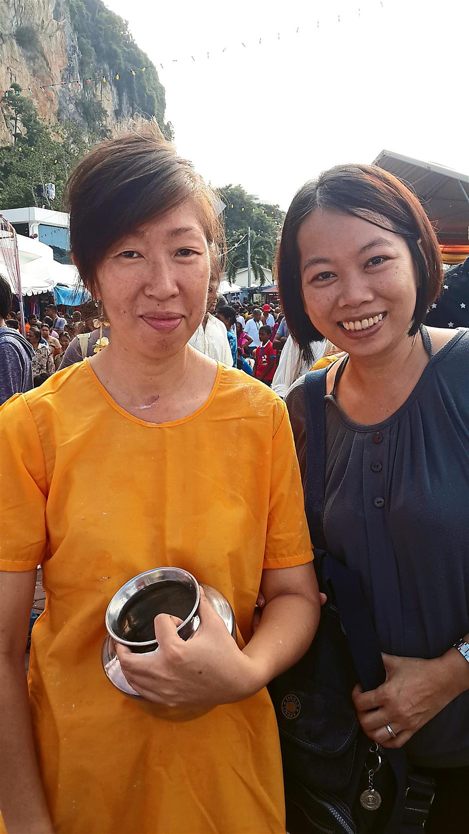 A test of faith: Molly Tan (left) and Tania Wong after their journey up the 272 steps to offer 'paal kudam' to Lord Murugan for their first time.