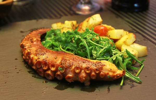 Roasted Octopus with roasted potato, arugula and balsamic vinegar.