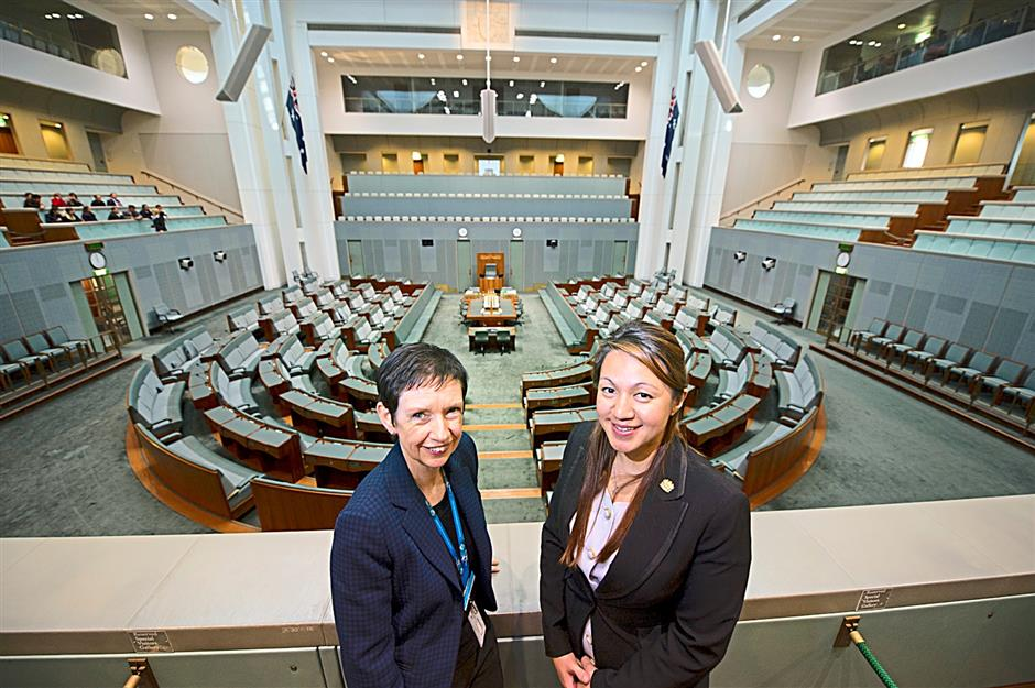 Memorable visit: Secretary of Department of Parliamentary Services Carol Mills with young Malaysian diplomat Delfina Dris at the House of Representitives Chamber in Parliament House, Canberra, Australia. Photo by David Foote/DPS Auspic