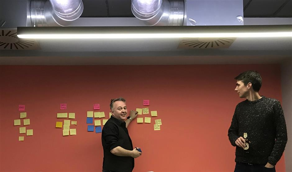 Mike Butcher and James Tabor, right, of Tech for U.K. discuss ideas for anti-Brexit digital products, in London, Thursday March 14, 2019.  Members of Tech For U.K., a grassroots group of people working in Britainu2019s tech industry, are using their tech skills to build online tools to help battle Brexit. (AP Photo/Kelvin Chan)