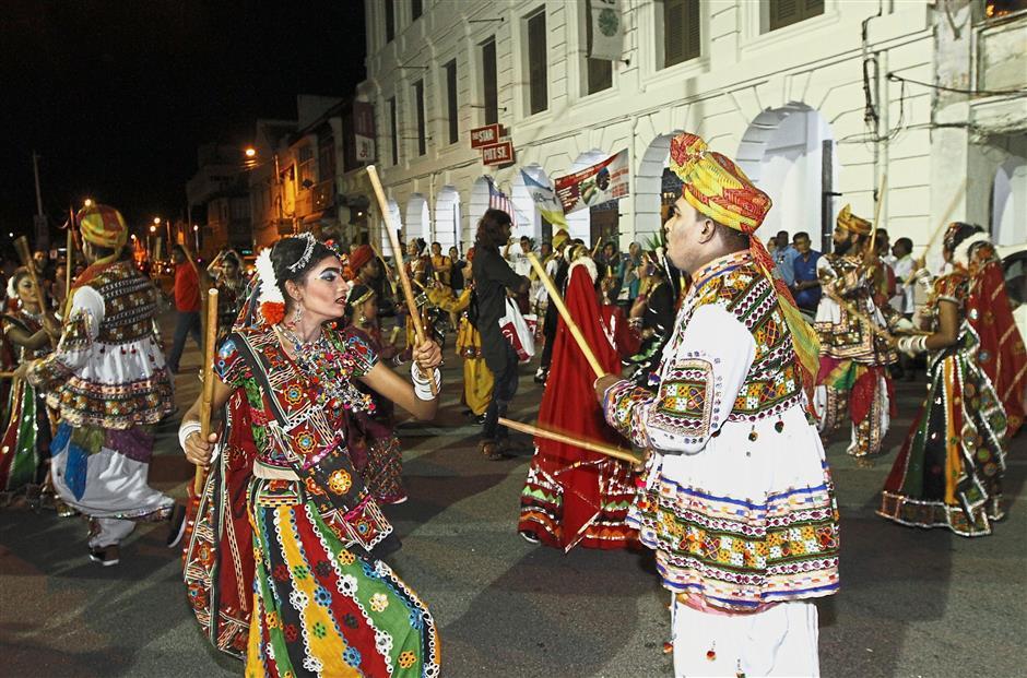Members of the Indian dance troupe performing kolattam in front of The Star Pitt St. building in Jalan Masjid Kapitan Keling. — Photos: LIM BENG TATT/The Star
