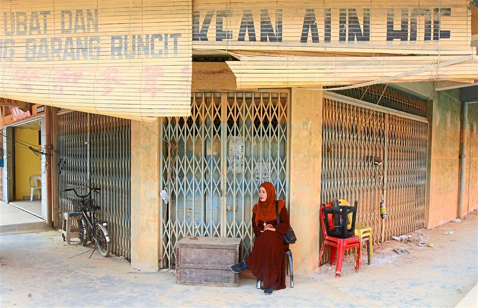 Shut down: In Kuala Krai, shops which have been operating for decades remain closed as their losses were massive.