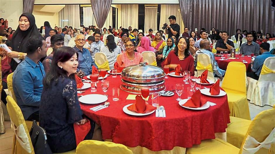 Guests enjoying the food and performances at the anniversary dinner.