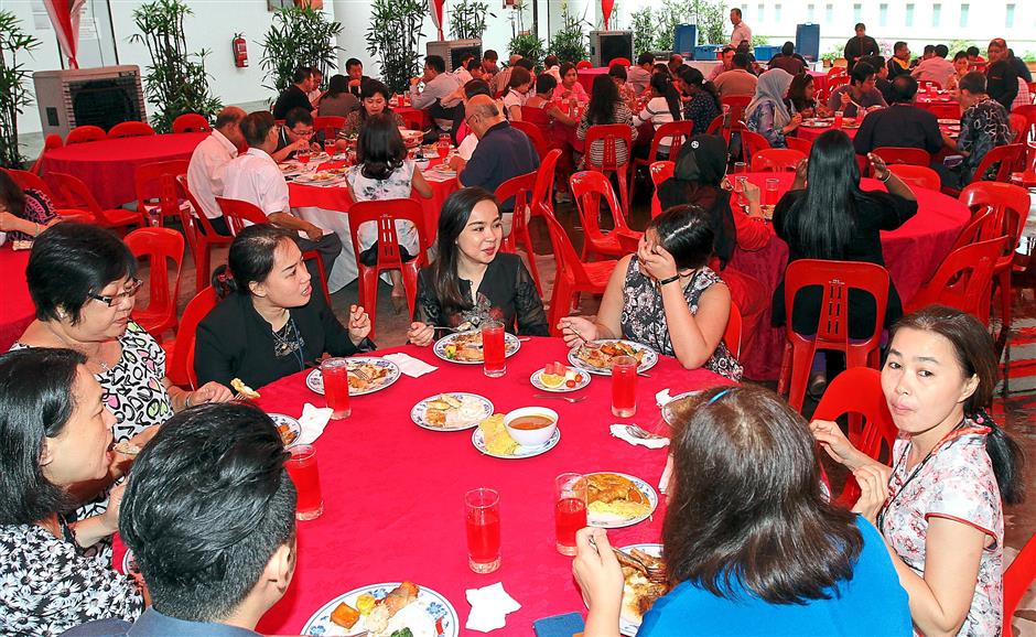 The happy team tucking in at The Star's 44th annivesary at Star Northern Hub in Bayan Lepas, Penang. WAN MOHIZAN WAN HUSSEIN 09.09.2015THE STAR