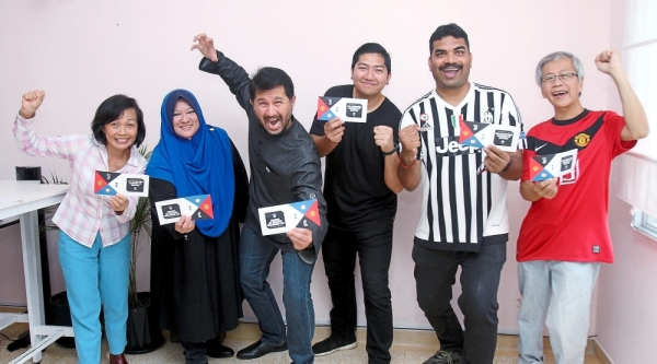 (From left) Lee, Roseliza, Wan Haslan, Mario, Balamoorali and Kok celebrating their win during the ticket presentation  ceremony for the contest.