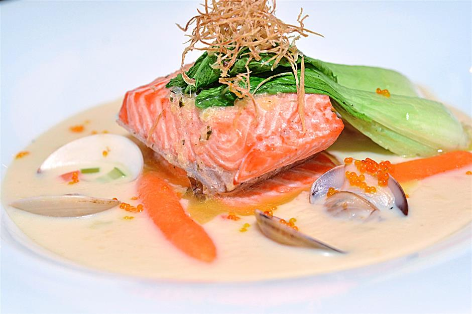 Poached salmon on creamy clam chowder, one of the seven dishes on the Salmon Fest menu at Zende Restaurant, Seri Pacific Hotel, KL.