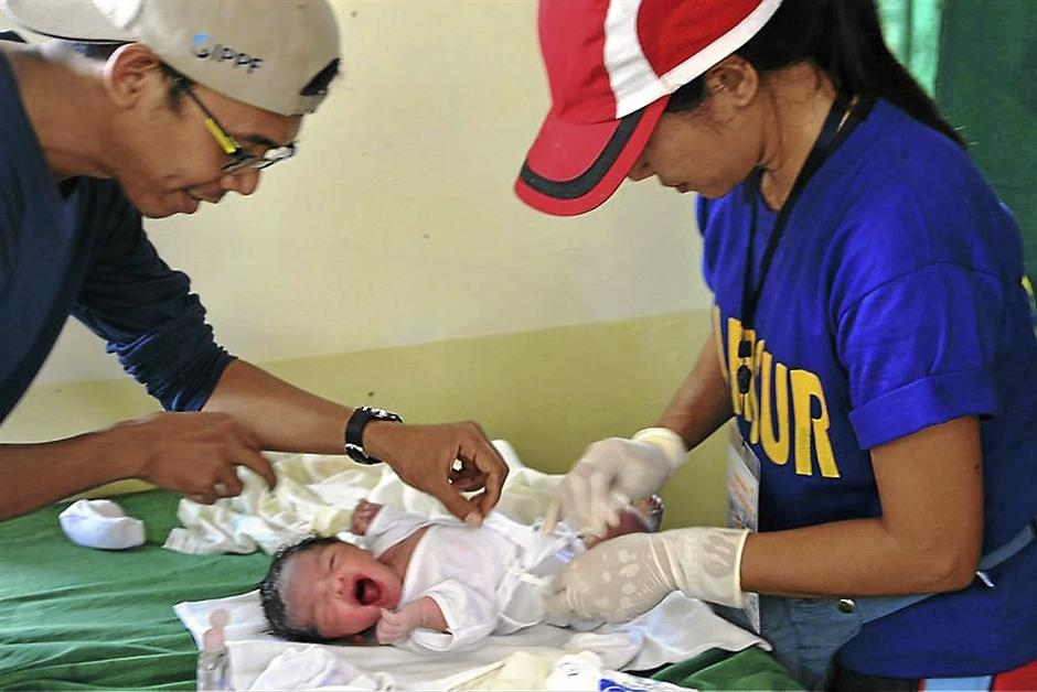 USE SMALL, QUALITY NOT SO GOOD: Fragile life: It is estimated that 900 babies like this one are born daily in the Typhoon Haiyan-hit regions of the Philippines.