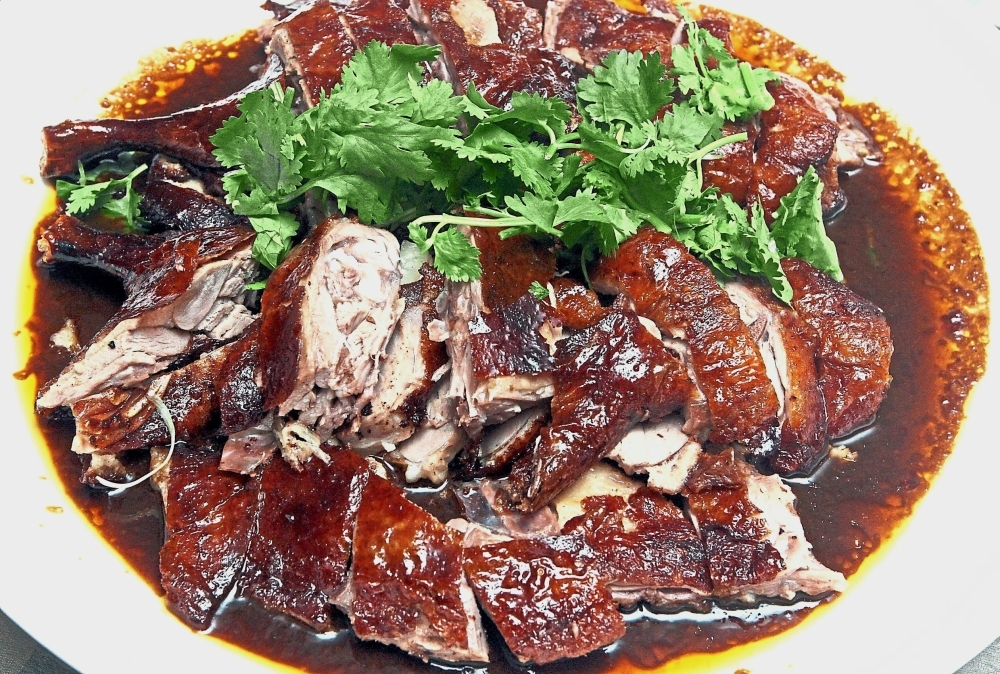 The skin of the Roast Pei Pa Duck is crispy while the meat is tender with  a hint of  smokiness.