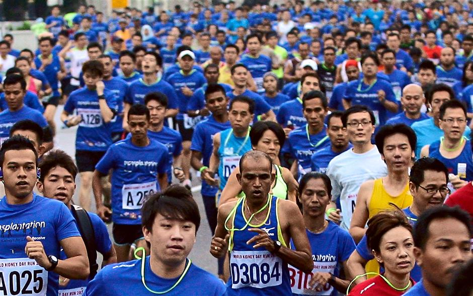 Runs have become a popular activity in Malaysia and Co-Martinent has signed up for one with her husband. — filepic