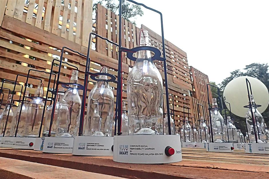 Some of the bottles that were lit up during the Pernod Ricard Malaysia's 2015 Bottled Hope Race and Bottled Hope Day held last Sunday (June 7) at Padang Merbok in Kuala Lumpur.