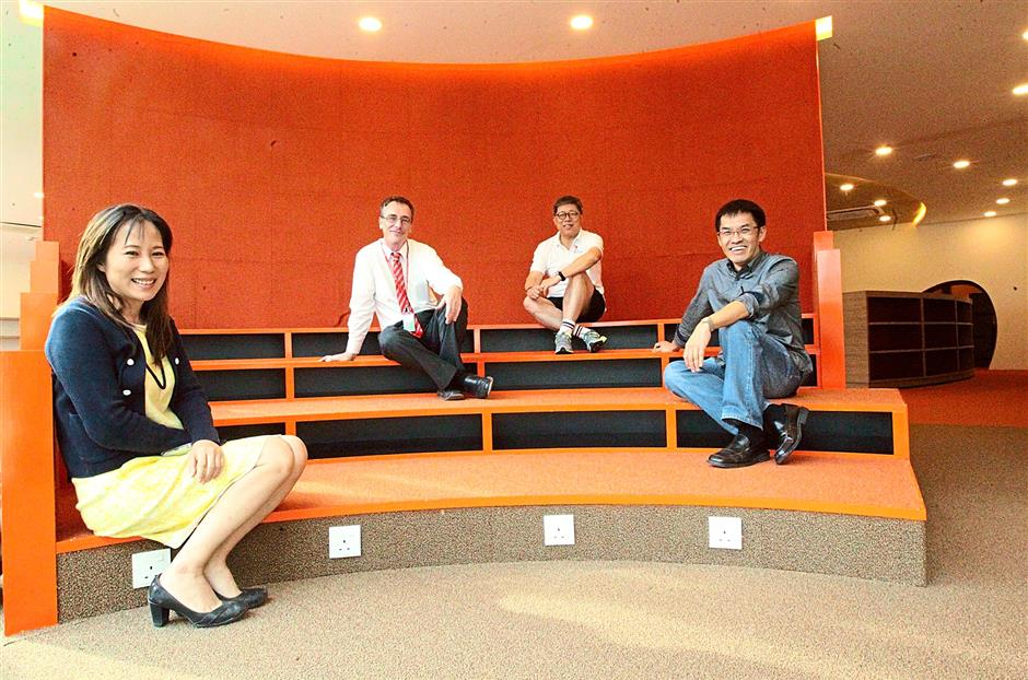 Inspired collaboration: (From left) Su, Rogers, Gan and Ng in the school's mini amphitheatre.