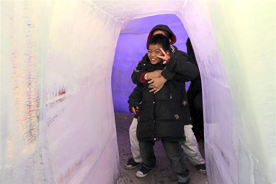 I see you: The children making their way through the man- made igloo.