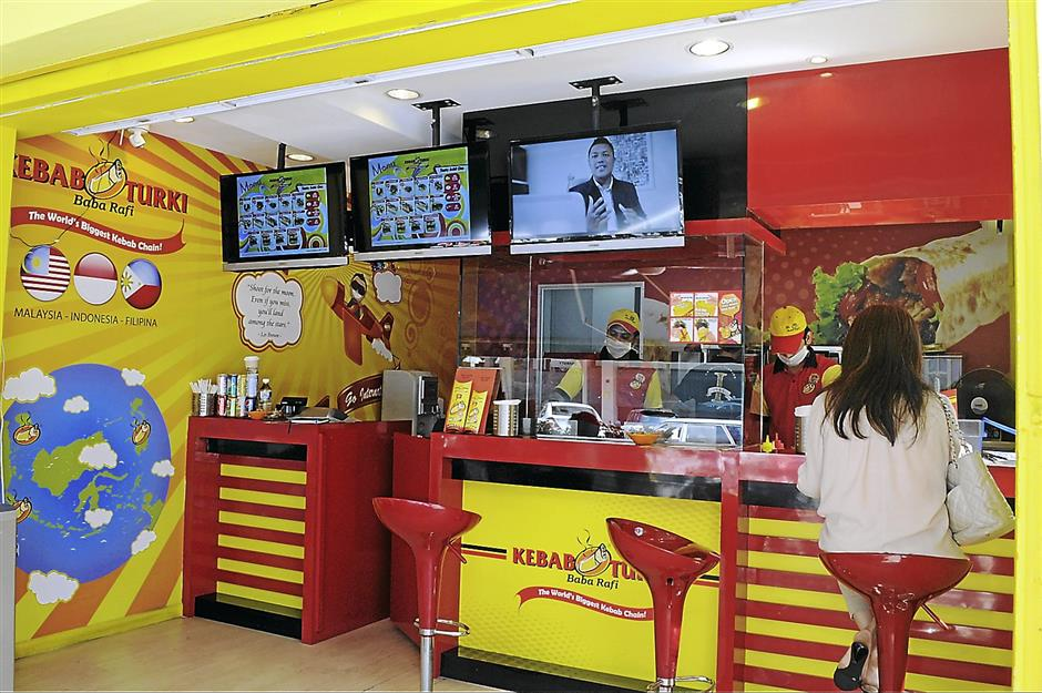 The Kebab Turki Baba Rafi outlet in Jalan Telawi, Bangsar is equipped with television screens and high stools for customers waiting for their kebab to be served.r. AHMAD SHAHRIN / The Star.