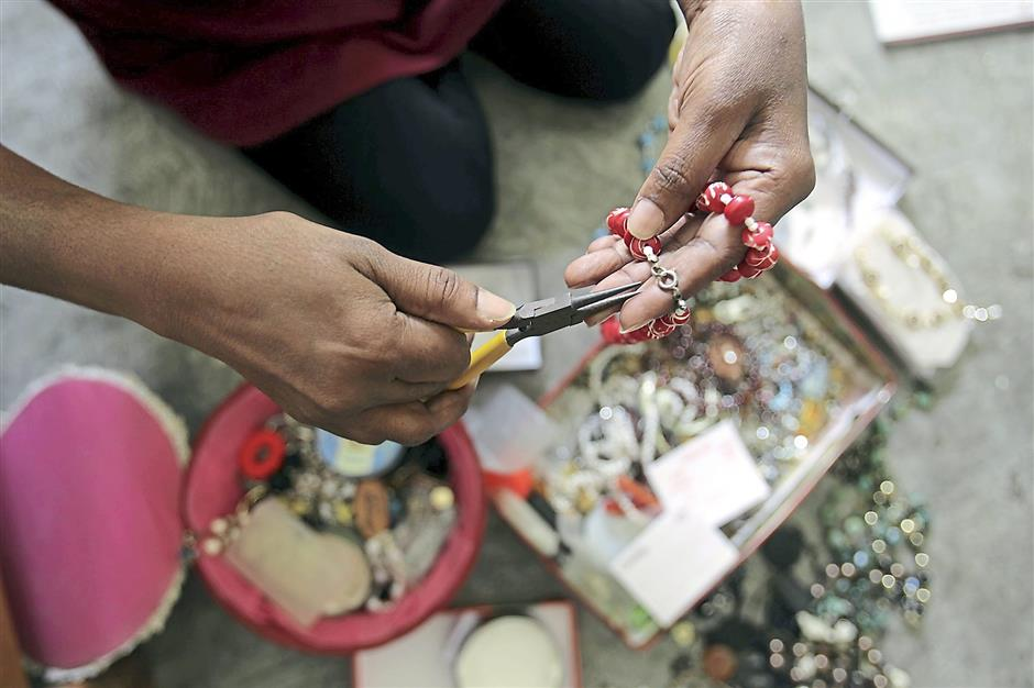 Sumathi's situation changed for the better when she took up a beadworking course. Photos: ART CHEN/The Star