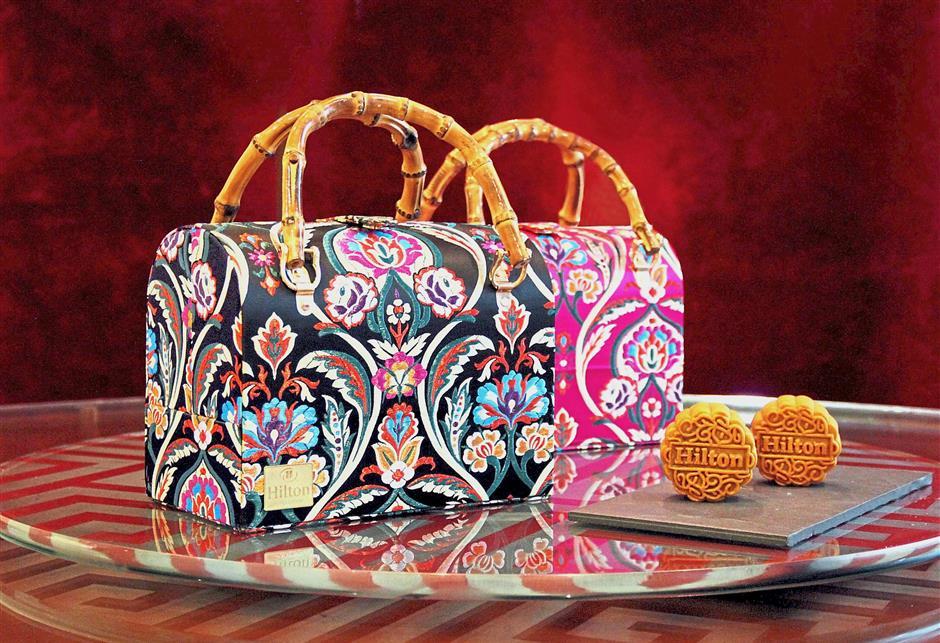Hilton Kuala Lumpur offers a special designer-mooncake bag by Khooi Hooi.