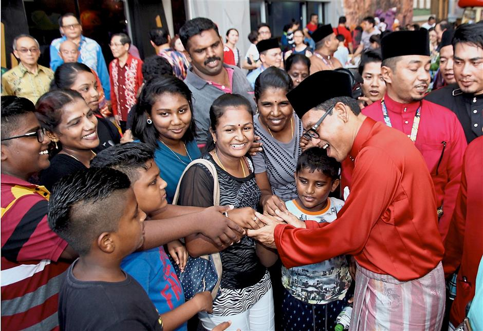 Mentri Besar Ahmad Faizal Azumu (right) greeted hundreds of people during the event in the theme park