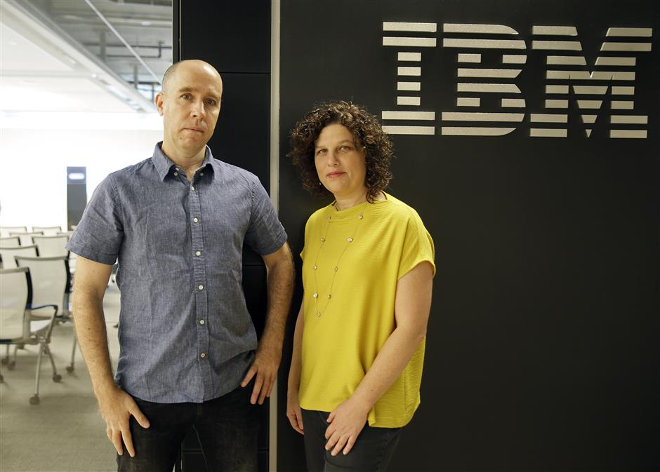 Dr. Noam Slonim, left, principal investigator and Dr. Ranit Aharonov, right, manager, pose near the IBM Project Debater before a debate between the computer and two human debaters Monday, June 18, 2018, in San Francisco. IBM on Monday will pit a computer against two human debaters in the first public demonstration of artificial intelligence technology it\'s been working on for more than five years. The system, called Project Debater, is designed to be able to listen to an argument, then respond in a natural-sounding way, after pulling in evidence it collects from Wikipedia, journals, newspapers and other sources to make its point. (AP Photo/Eric Risberg)