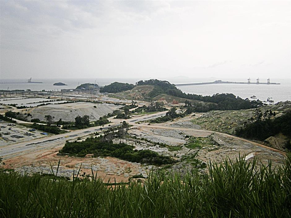 The Vale Malaysia Minerals iron ore stockyard and distribution centre is built on an old golf course in Teluk Rubiah, Lumut, Perak. Some 400,000 tonnes of iron ore will be shipped monthly from Brazil to the site, for redistribution in the region.