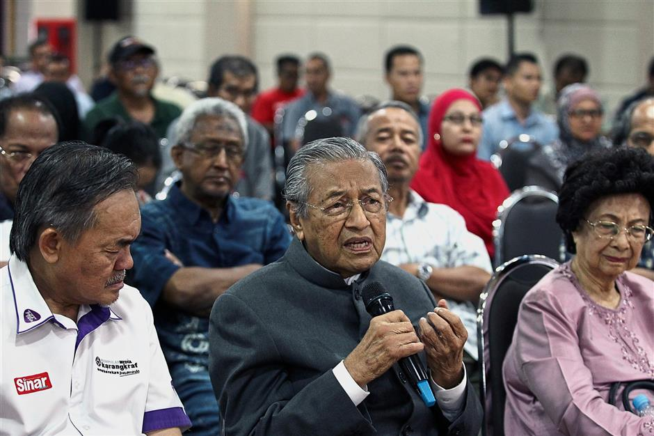 Setting the record straight: Dr Mahathir, accompanied by Dr Siti Hasmah, speaking at the forum in Shah Alam.
