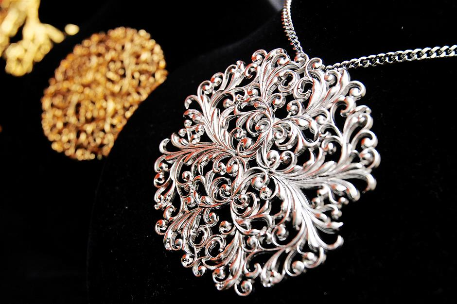 This costume jeweller's favoured material is pewter plated with gold or rhodium.