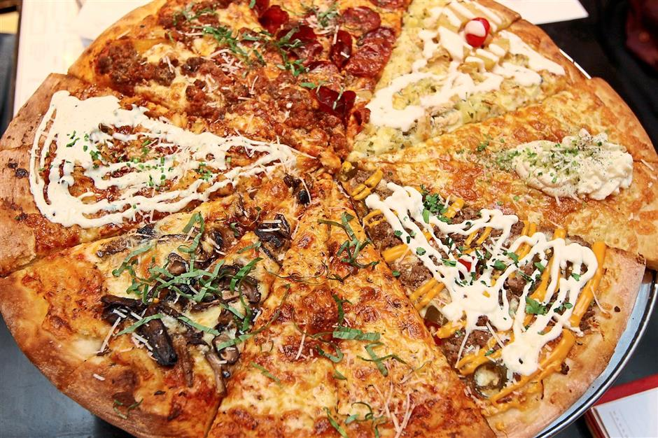 Rainbow pizza: Some of the pizza flavours available are (clockwise, from bottom centre) Classic New York, Mama's Wild Mushroom, BBQ Chicken, Meatball, The Tony Soprano, Sweet Hawaiian, Bianco, and Mexican.