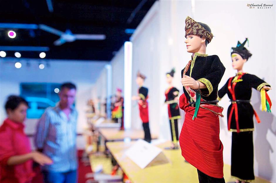 Ethnic display: Dolls garbed in traditional costume at Chanteek Borneo Gallery in Tamparuli.