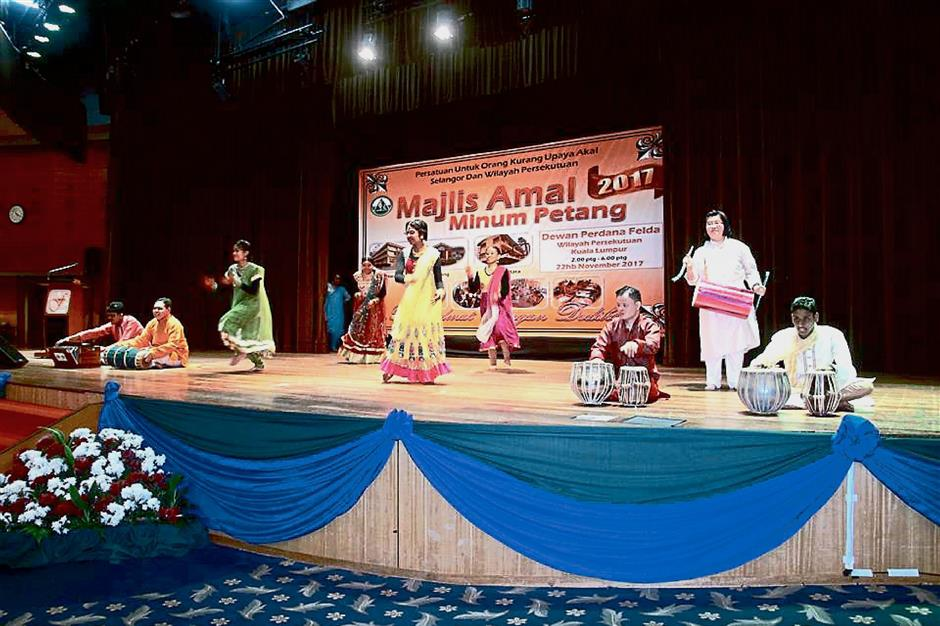 Trainees from the association performing an Indian dance number titled Jimmiki Kammal.