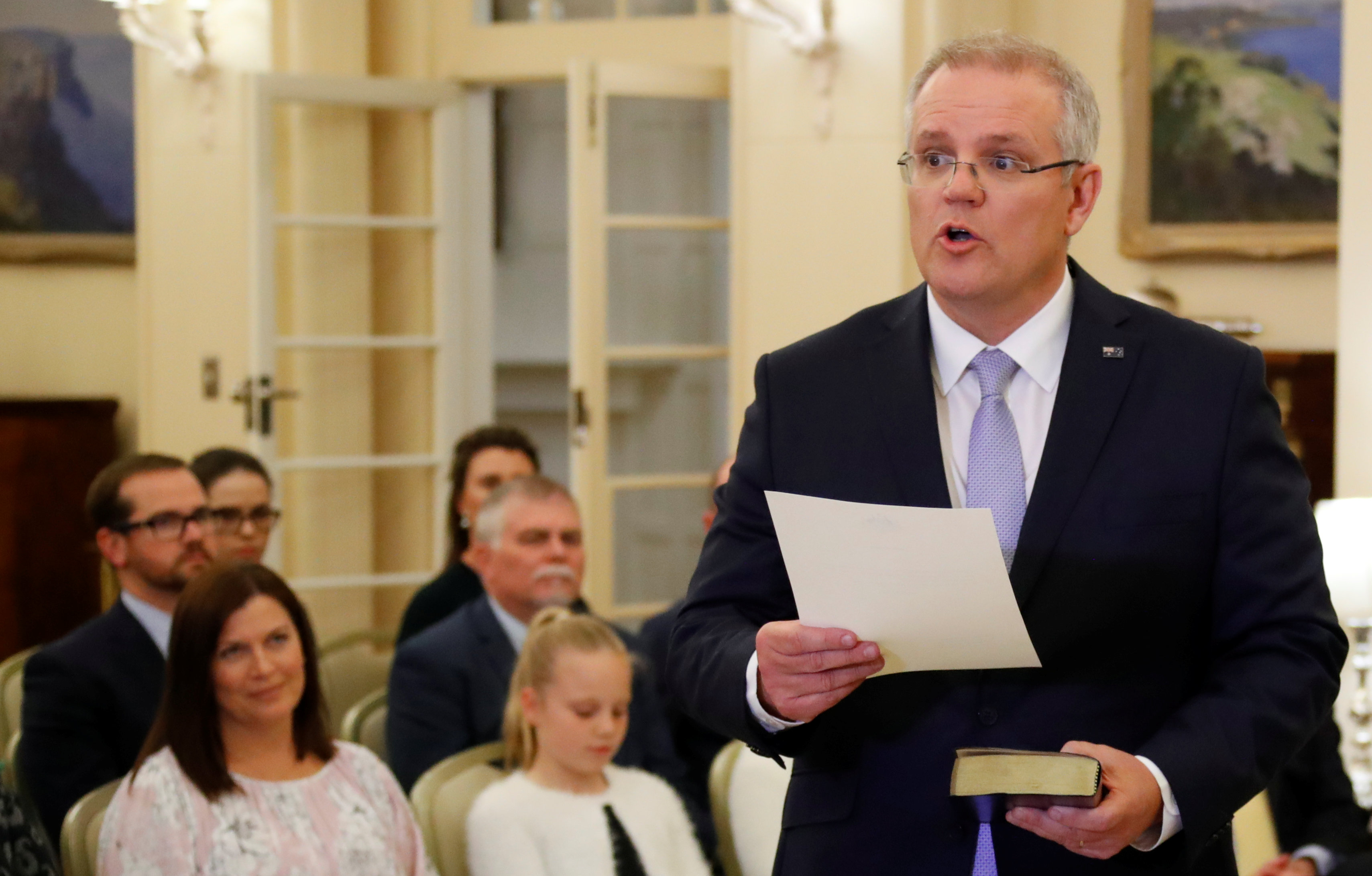 FILE PHOTO: The new Australian Prime Minister Scott Morrison attends a swearing-in ceremony as his wife Jenny looks on, in Canberra, Australia August 24, 2018.  REUTERS/David Gray