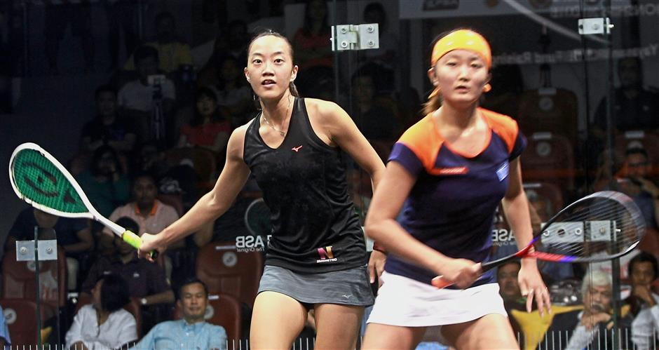 Marvellous comeback: Malaysia's Low Wee Wern (left) and Satomi Watanabe of Japan battle it out in the women's singles final of the Malaysian Open Squash Championships at the National Squash Centre yesterday. Wee Wern, playing in only her second tournament since a 20-month layoff, won 11-8, 11-7, 11-4 for a first PSA title since 2014.