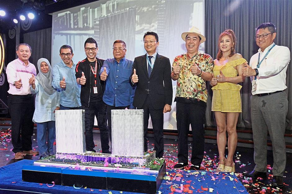 (From left) Former state executive councillor Datuk Danny Law, Datin Fauziah Tahir, her husband, who is Telok Ayer Tawar assemblyman Mustafa Kamal Ahmad, Zeon Properties Sdn Bhd CEO Leon Lee, REHDA Penang chairman Datuk Toh Chin Leong, Yeoh, Swee Kheng and wife Datin Elaine Sit, and Ewein Bhd chairman Datuk Sri Ewe Tiong Hor launching the City Of Dreams Appreciation Cruise at Swettenham Pier in George Town.