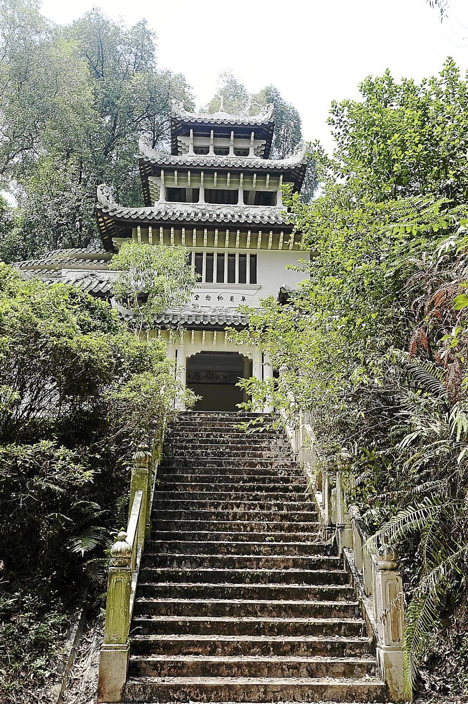 Special remembrance: A four-storey elaborate memorial hall was built next to Loke Yew's grave but is left vacant. Strangely, the building has no staircase leading to the upper levels.