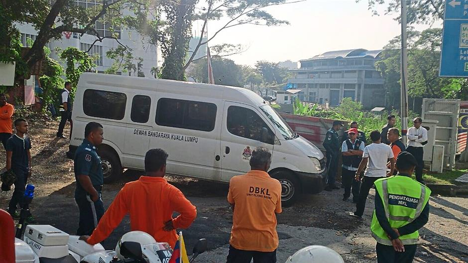 Out in force: DBKL officers at the scene to shut down the illegal parking lot and dumpsite.