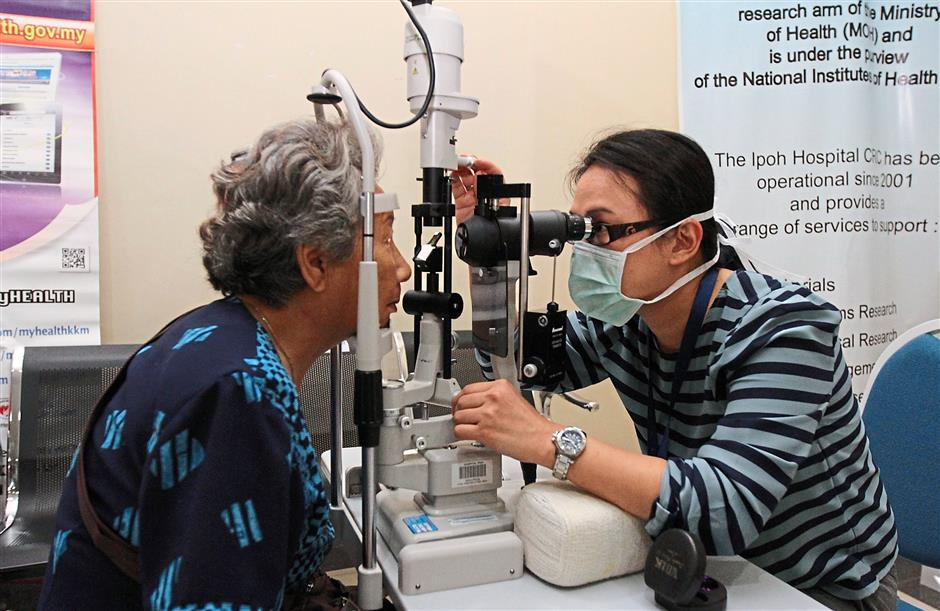 2 The elderly getting free eye checks to help cut costs. — filepics