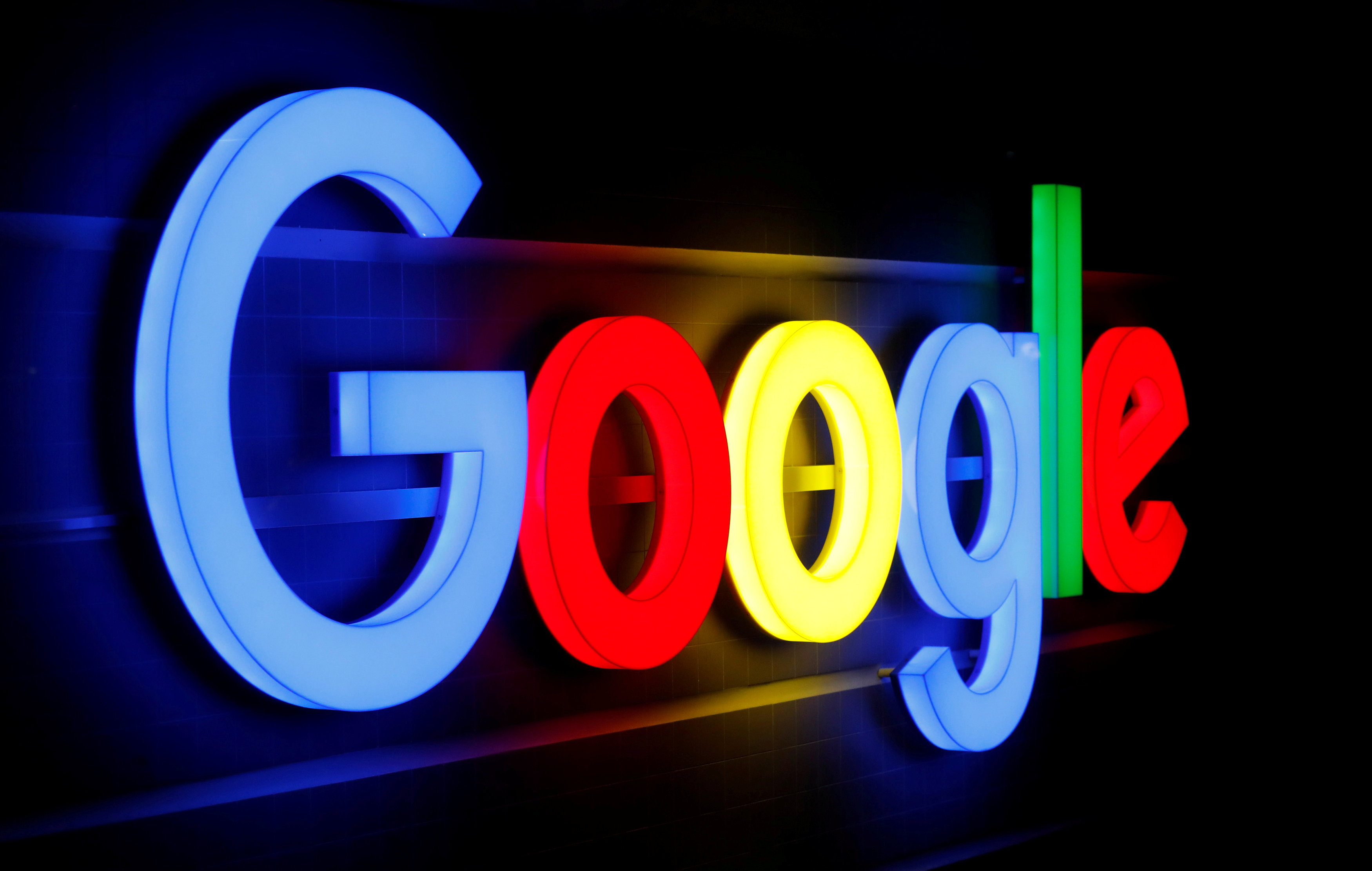 An illuminated Google logo is seen inside an office building in Zurich September 5, 2018. REUTERS/Arnd WIegmann/Files