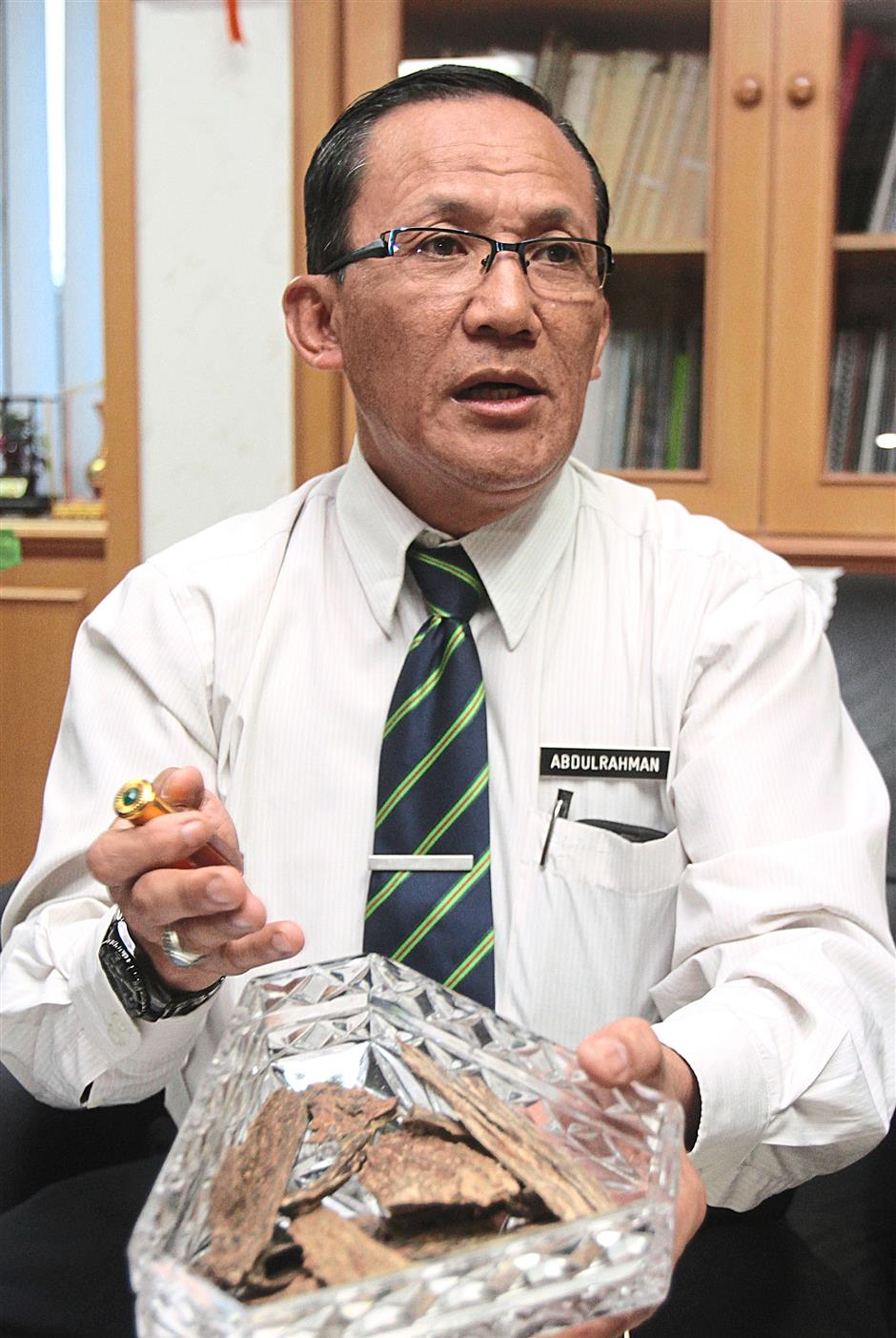 Hefty: Forestry Department of Peninsular Malaysia director-general Datuk Prof Abd Rahman Abd Rahim showing some high quality agarwood wood chips and a bottle of essence oil, which will cost around RM30,000 at the current market price. -- M. Azhar Arif/The Star 6 March 2014
