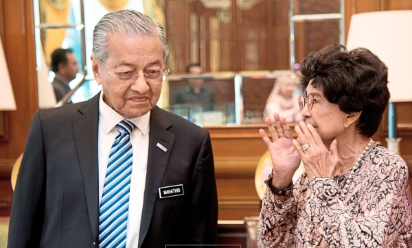 Marking a milestone: Dr Mahathir and Dr Siti Hasmah attending his birthday celebration at the Prime Minister's Office in Putrajaya. — Photo courtesy of PMO Media