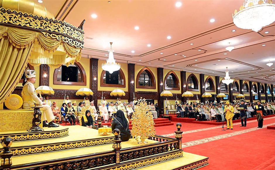Regal splendour: Sultan Nazrin seated with ?Tuanku Zara in the Balairong Seri hall on ?enthronement day?.