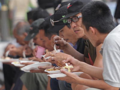 Let the feast begin: The homeless in Chow Kit, Kuala Lumpur, tucking into a lunch provided by GSM.