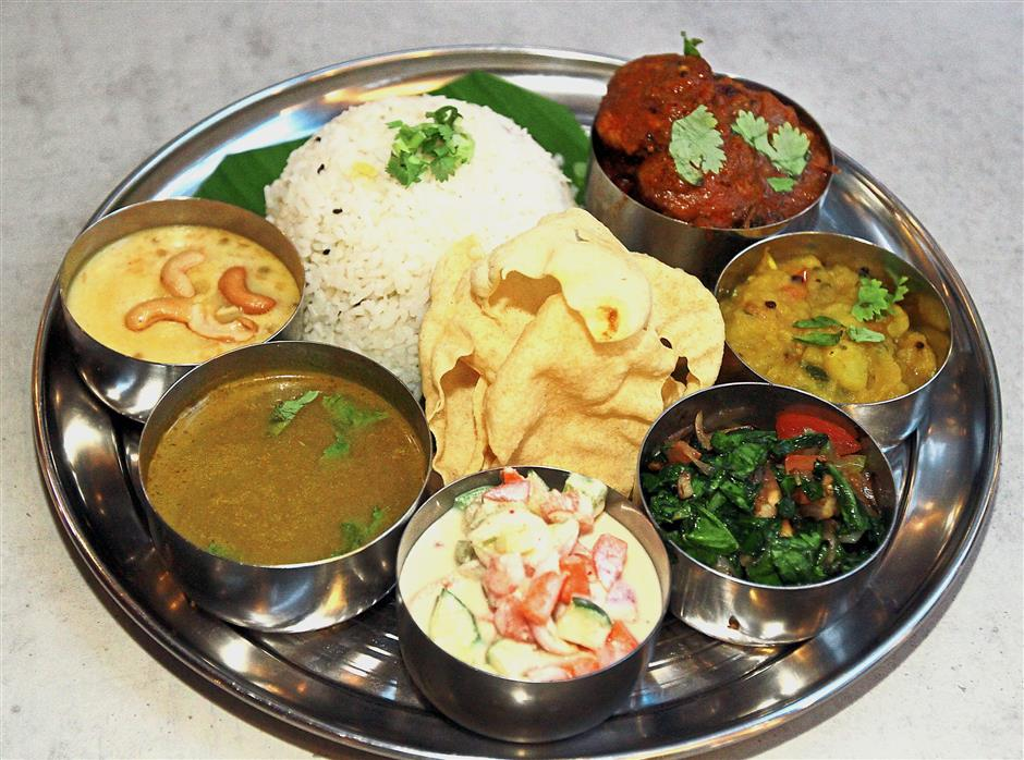 Besides the chicken thali set pictured here, the restaurant also offers vegetarian, mutton and fish sets.