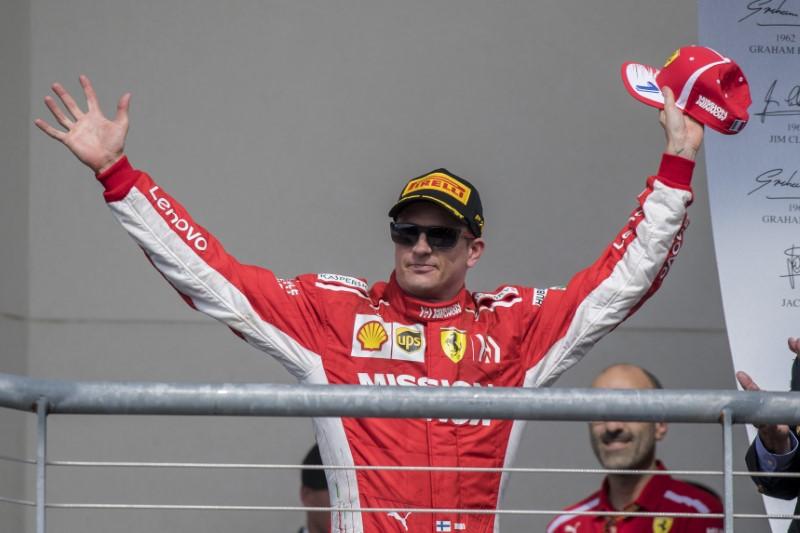 Oct 21, 2018; Austin, TX, USA; Ferrari driver Kimi Raikkonen (7) of Finland celebrates winning the United States Grand Prix at Circuit of the Americas. Mandatory Credit: Jerome Miron-USA TODAY Sports