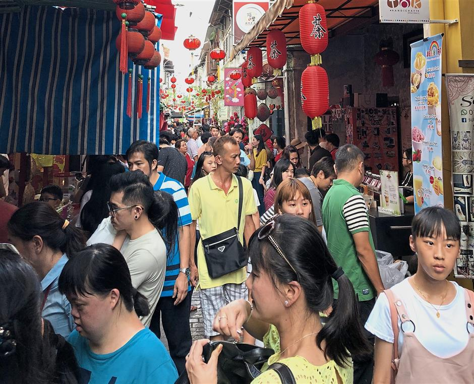 Concubine Lane was flooded with tourists during the Chinese New Holidays.