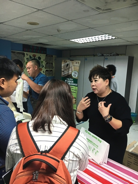 Sai (right) says traders should be aware of fake biodegradable plastic bags.