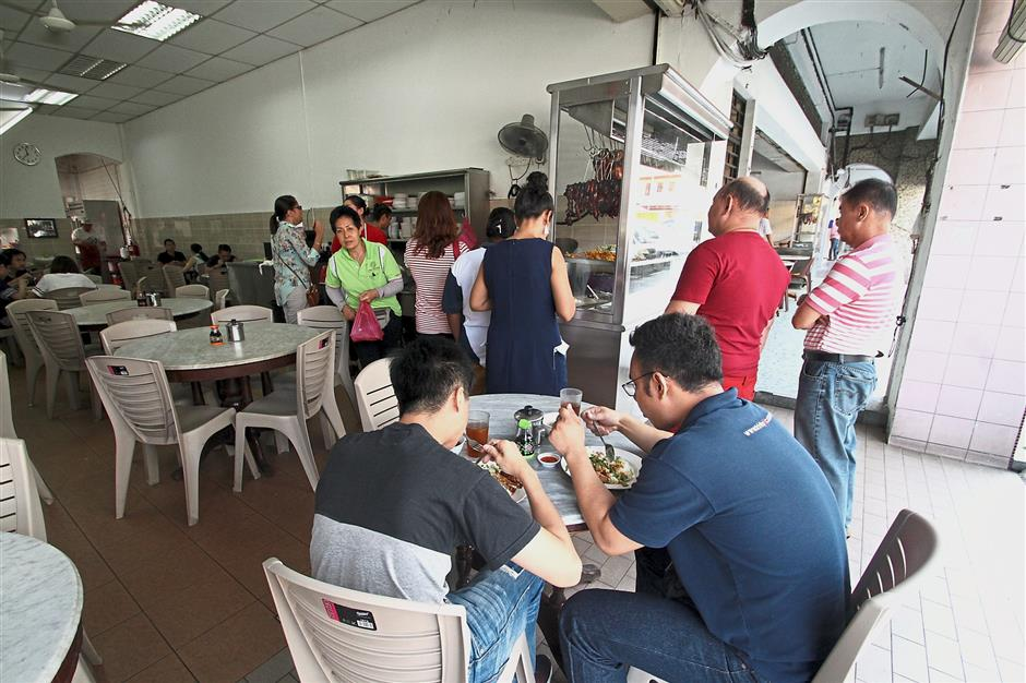 People from as far as Singapore have been calling the operators of Nasi Ayam Pak Kong to check if they are open on polling day.