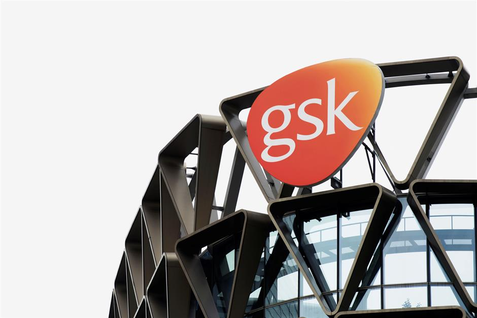 FILE PHOTO: The GlaxoSmithKline (GSK) logo is seen on top of GSK Asia House in Singapore, March 21, 2018. Picture taken March 21, 2018. REUTERS/Loriene Perera/File Photo