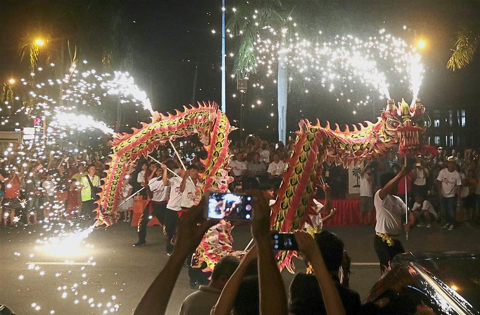 (BRIEF CAPTION) Dragon dance with fire work performance during the Penang Chingay Festival Parade 2018 at Padang MPSP in Bagan Luar, Butterworth. Pic by: Zhafaran Nasib / The Star/ 23 December 2018.