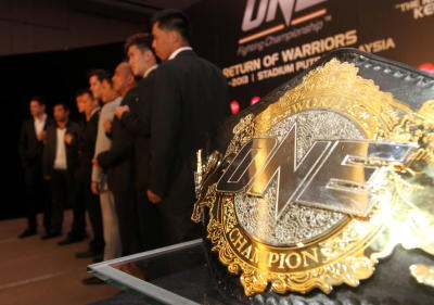 Go for gold: The ONE Fighting Championship belt which will be up for grabs in the match between two Filipino fighters, Honorio u2018The Rocku2019 Banario and Eric u2018The Naturalu2019 Kelly, on Feb 2 next year at Stadium Putra, Bukit Jalil.