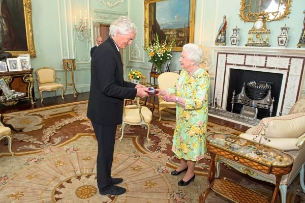 Royal meet: Britain's Queen Elizabeth presenting Dyson with the insignia of members of the Order of Merit during a private audience at Buckingham Palace in 2016. — Reuters
