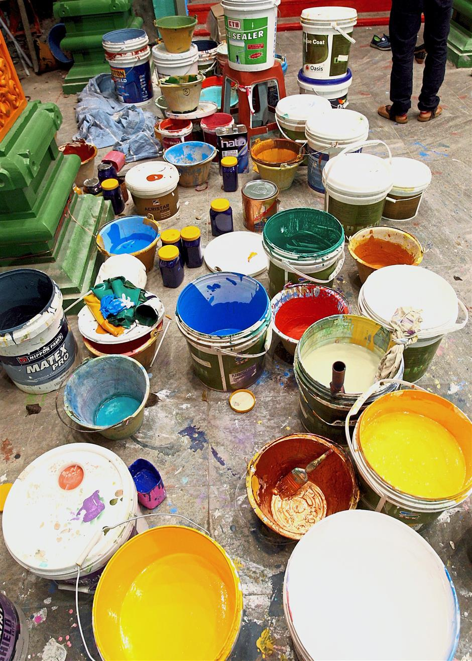 Buckets of colourful piants were used to paint the steps.