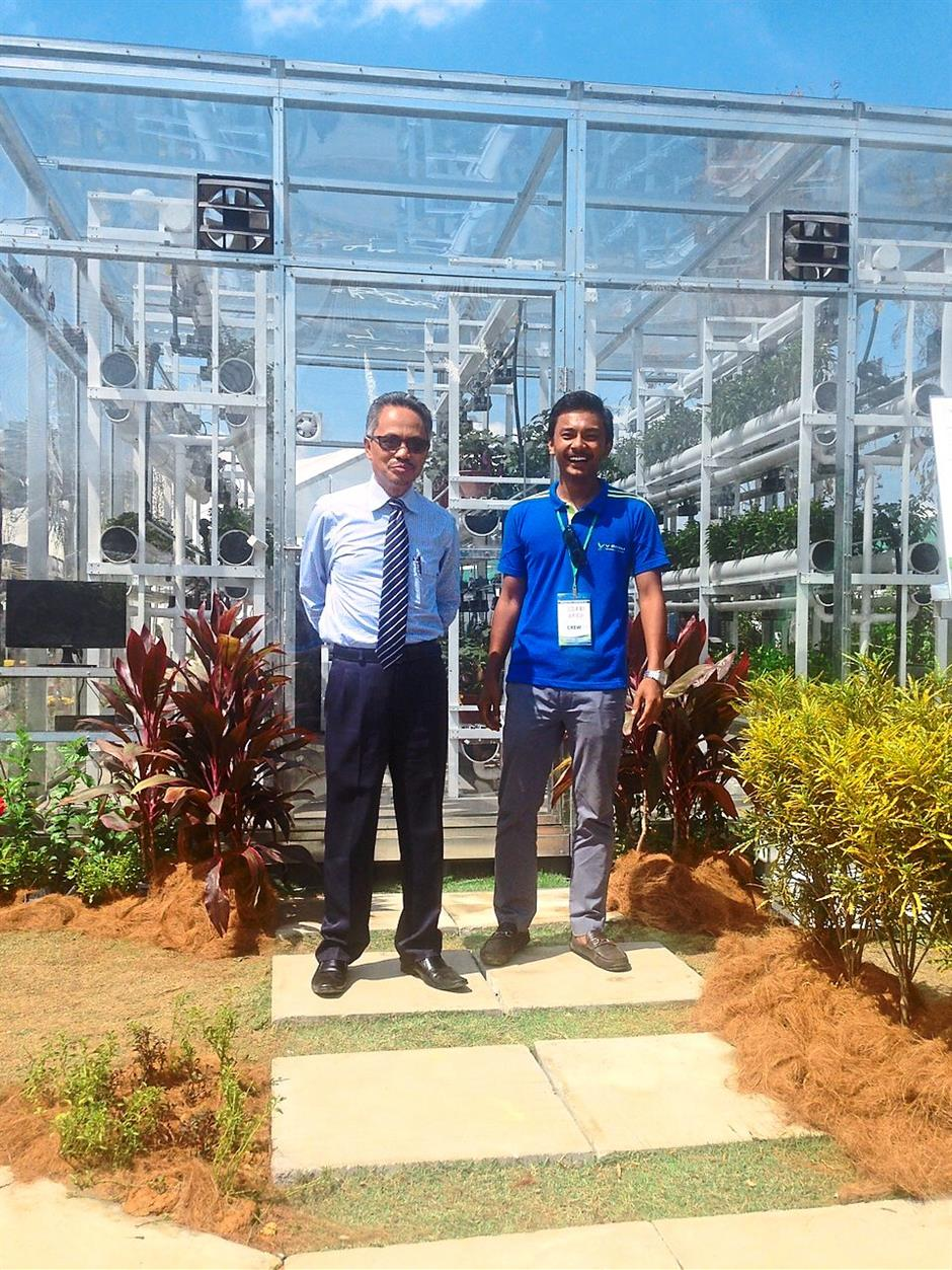 DREAMING BIG: Azri Zahier (right) with Family director-general Datuk Ahmad Isham in front of his hi-tech agriculture venture VCube.