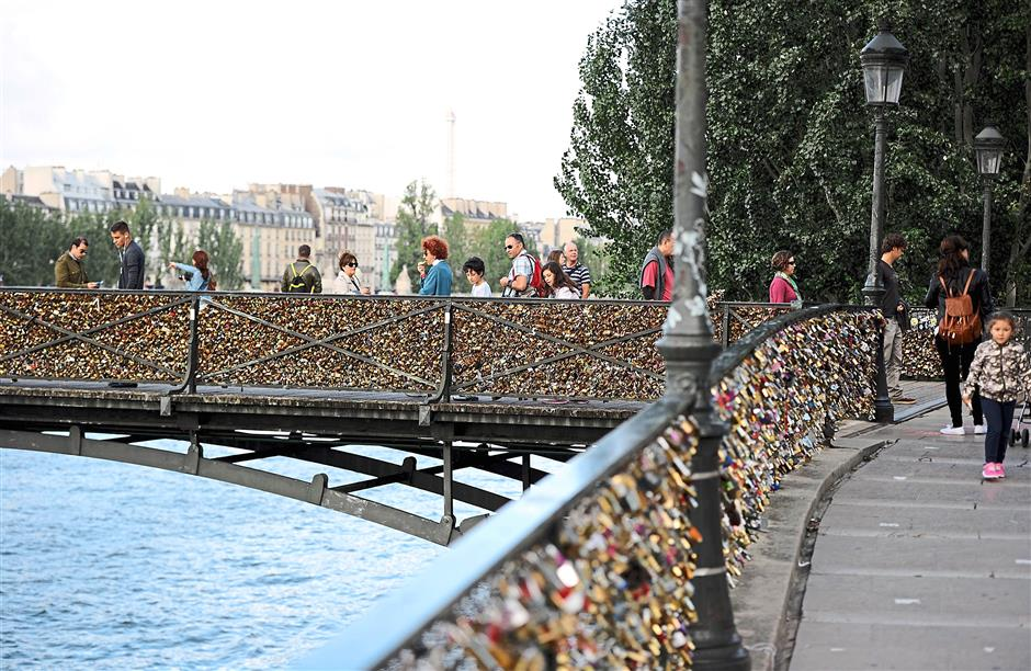 It's been estimated that the Pont des Arts footbridge groans under a massive weight of about 45 tonnes of 'love locks'. - AFP